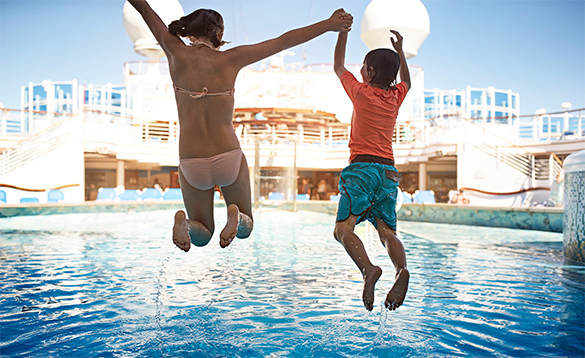 Two children jumping into a pool oboard a Princess Cruises ship/