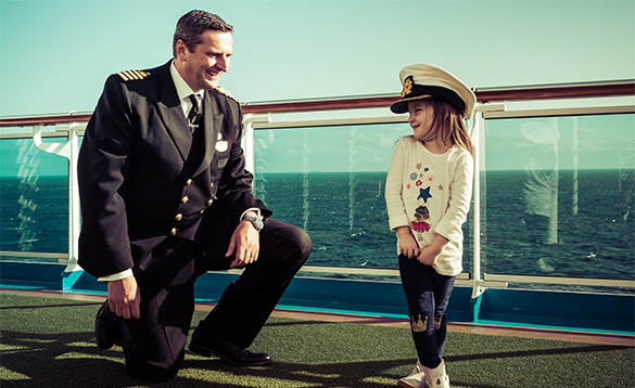 Child wearing the Captain's hat onboard a Princess Cruises ship/