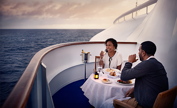 Couple enjoying a meal on thier balcony onboard a Princess Cruises ship/