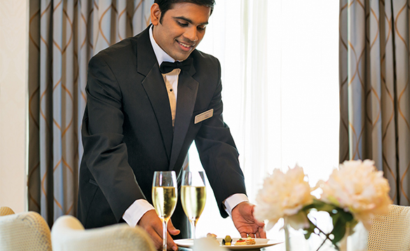 Waiter serving food and drinks on a Regent Seven Seas cruise ship/