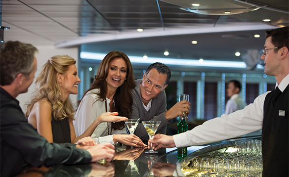 Group of passengers enjoying drinks onboard a Regent Seven Seas cruise ship/