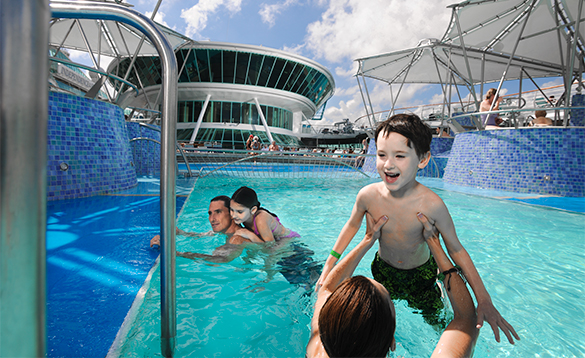 Family enjoying playing in the pool onbaord a Royal Caribbean cruise ship/