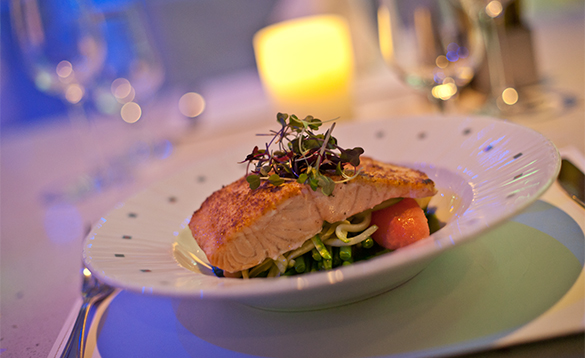 Salmon served on a bed of vegetables onboard a Royal Caribbean cruise ship/