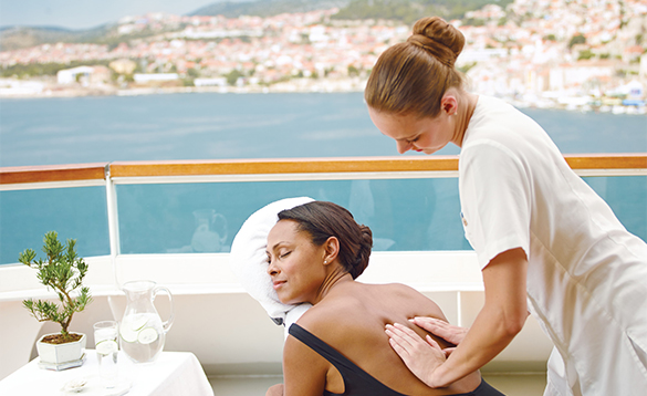 Lady enjoying a massage on a Seabourn cruise/