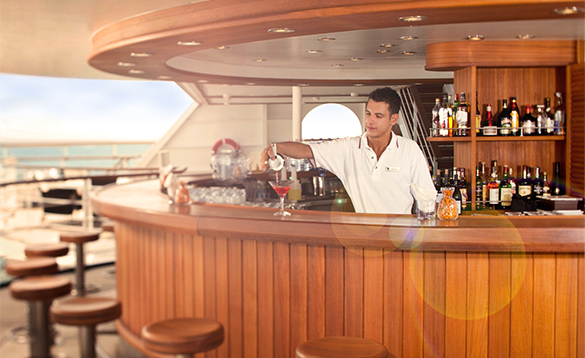 Waiter pouring a cocktail in the Sky Bar aboard a Seabourn cruise ship/