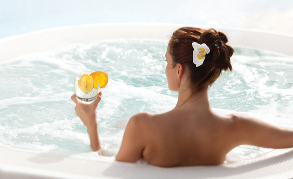 Lady relaxing in the jacuzzi with a drink aboard the Silver Wind cruise ship/