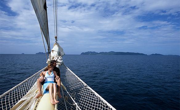 Couple enjoying views from a Star Clippers ship/