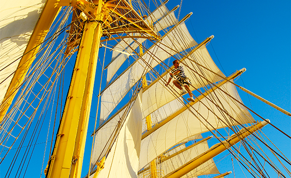 Man climbing the rigging on a Star Clippers ship/
