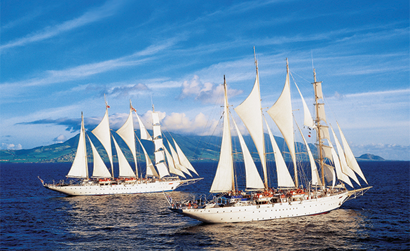 Two Star Clippers ships in full sail at sea/