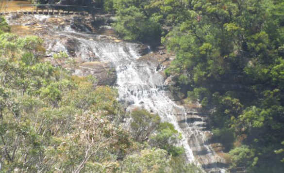 waterfall cascading down a rocky hillside/