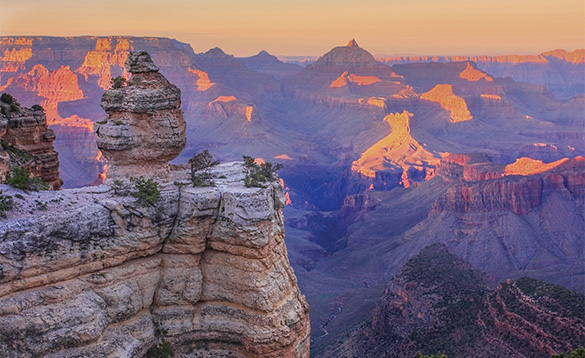 view of sun rising across the Grand Canyon/