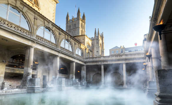 Steaming spa baths with ornate stonework in Bath/