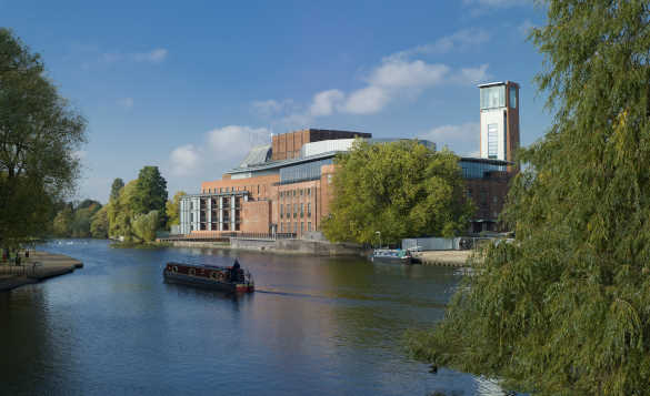 Sightseeing boat cruising past the Royal Shakespeare Theatre in Stratford Upon Avon/