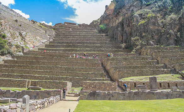 large terraces of the Inca Ruins in Peru leading up a hillside /